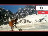 Holy man digs through ice to take an outdoor bath in the Himalayan mountains | SWNS TV