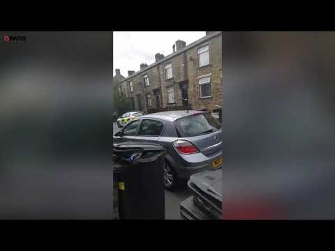 Moment a pervert sparked a five-hour rooftop standoff | SWNS TV | SWNS TV