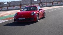 The new Porsche 911 Carrera 4S Guards Red on the Race Track