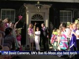 Royals Will, Kate welcome torch at Buckingham Palace