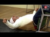 Injured Man Falls Off Chair