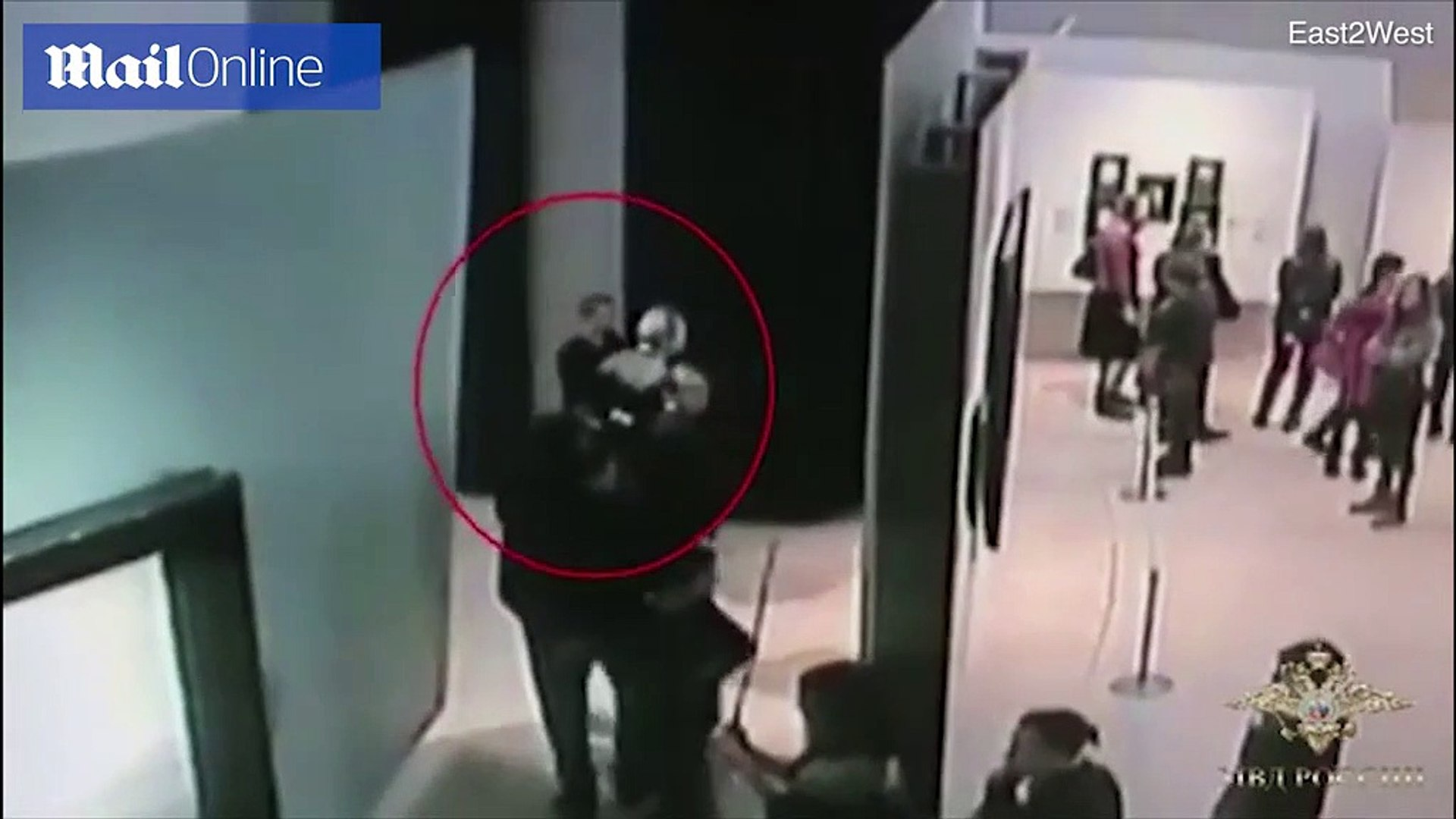 CCTV shows a man stealing a painting in front of staff and visitors