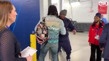Todd Gurley runs into Marshawn Lynch on his way to Super Bowl LIII postgame press room