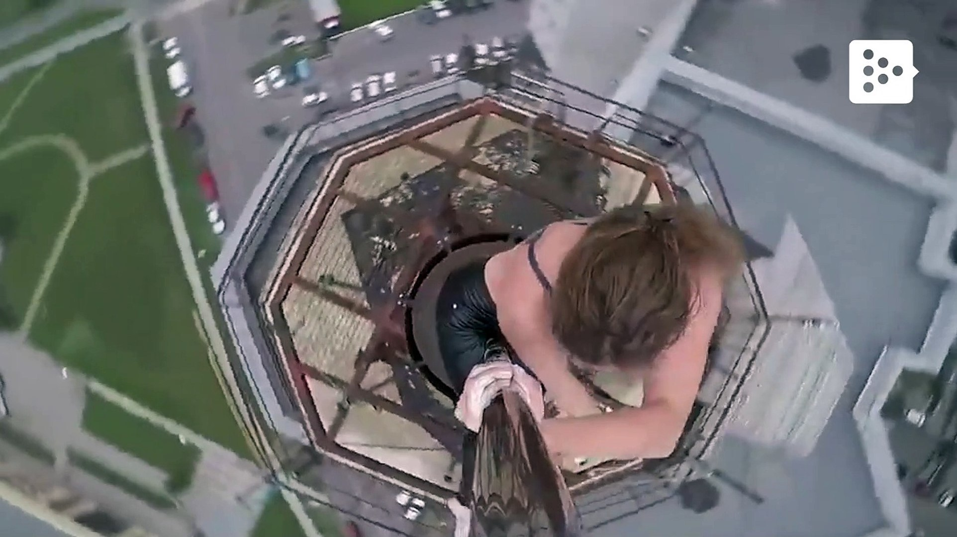Russian pole dance dancer performs on the top of a 16-story building
