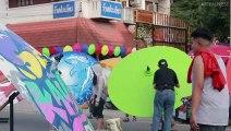 Graffiti Artists Spray Umbrellas