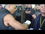 CHRIS EUBANK JR WRAPS HIS HANDS W/ RONNIE DAVIS UNDER MONOCLED EYE OF CHRIS EUBANK SR *ENGLISH*