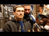 STONE FACED OLEKSANDR USYK SEEMS UNIMPRESSED AS TONY BELLEW GATE-CRASHES HIS INTERVIEW