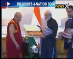 PM Modi presents 'Urga Kanjur' to Head Priest, Datsan Gunzechoinei Buddhist Temple