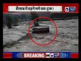 Manali highway blocked, Tourist bus gets washed away by Flooded River  near  Himachal Pradesh