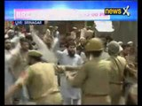 Geelani put under house arrest in Sinagar, protesters clash with police outside his residence