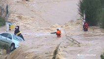 Dramatic rescue of man trapped on top of car, surrounded by floodwaters