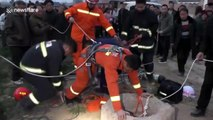Fireman hangs upside-down to save old woman trapped in well in China's Henan
