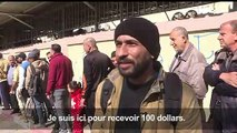 Des Palestiniens à Gaza reçoivent une nouvelle aide financière du Qatar