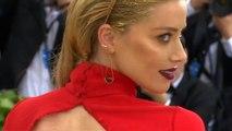 Amber Heard locks lips with director Andy Muschietti