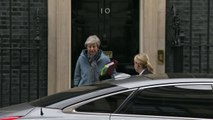 May departs Downing Street ahead of PMQs and Brexit votes