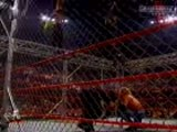 Jeff Hardy Jumps Off The Cage And Lands On Matt And Edge