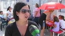 Niños de tres pueblos de Valencia comen en las puertas de los colegios, por los recortes