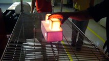 Children Touch 1200°C Cubes