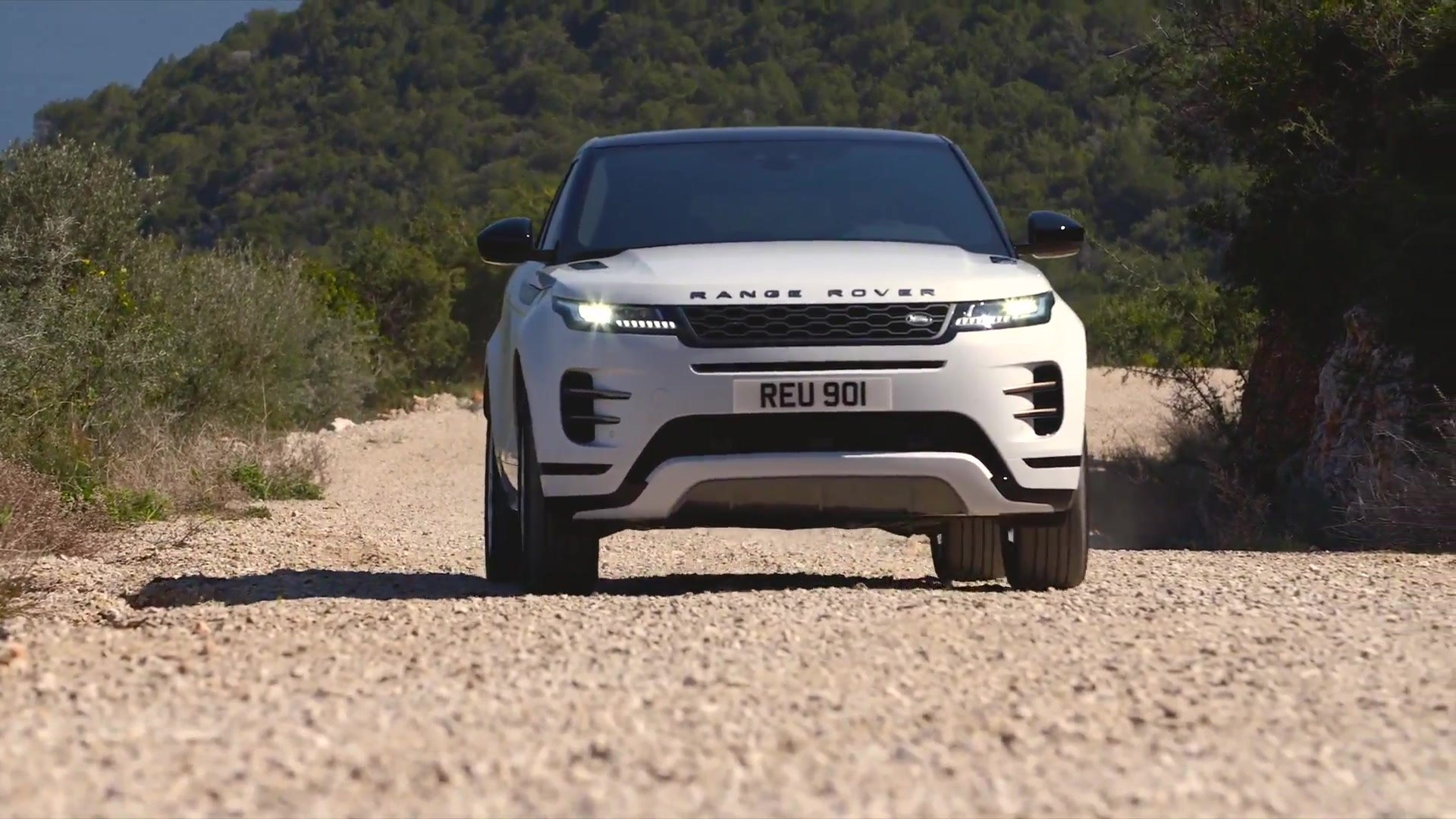 New Range Rover Evoque R-Dynamic S derivative in Yulong White Off-road  driving