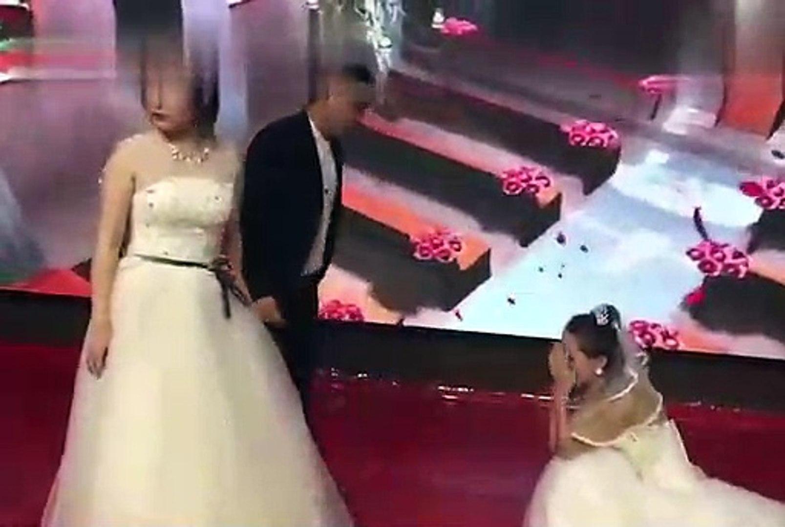 Cô gái mặc váy cô dâu xông vào đám cưới bạn trai cũ đòi quay lại