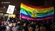 Colombians hold 'kiss-a-thon' to protest against homophobia in Bogotá shopping mall