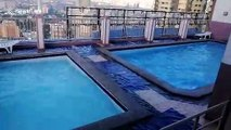 Swimming pools on tower block shake as earthquake hits the Philippines