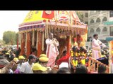 Gurus with followers and chariot during Rath Yatra, Delhi