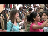 Foreigners dance with Indians at Wagah Border