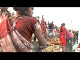 Devotees converge on the bank of Yamuna for Chatt puja