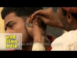 Cleaning dirty ears for a living - a job in India?