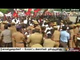 Tussle between the police and DMK cadres, who get past the barricade at Tambaram to stage rail roko