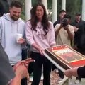 """Travis Scott is presented with his birthday cake, as everyone sings """"Happy Birthday"""""""
