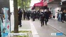 L'image choc d'un CRS qui ramasse un pavé et le balance sur des manifestants lors des affrontements du 1er Mai à Paris
