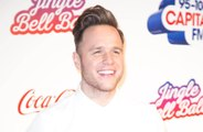 Olly Murs dressed up as Kylie Minogue for Robbie Williams on tour