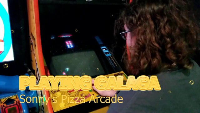 Playing GALAGA at the Sonny's Pizza Arcade in St. Francisville, Louisiana