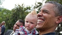 21 Pictures of President Obama Holding Babies