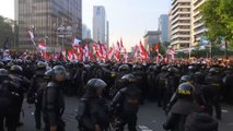 Protesters in deadly clash with Indonesian police after re-election of President Joko Widodo