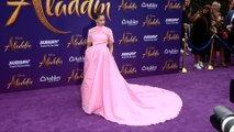 Naomi Scott dazzles in bubblegum pink gown at Aladdin world premiere in LA