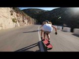 Two Girls Skate Down Expertly on Spanish Mountain Roads
