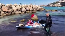 Marseille : les premiers participants de la course de ramassage des déchets arrivent aux Prophètes