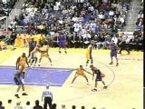 NBA BASKETBALL - Shaq sends Vince carter to the floor