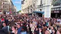 Fans of K-pop sensations BTS whoop in delight as band's Hyundai commercial is unveiled at London's Piccadilly Circus