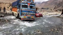 Leh Ladakh Road - This is tough. Flooding and rough terrain means that the cars get stuck and the bus makes it! Very entertaining.
