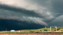 Huge storm clouds loom over Texas grasslands before floods hit town
