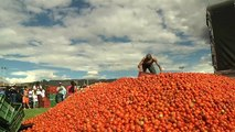 Watch: Locals paint the town red in Colombia tomato throwing festival