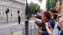 Protesters boo as Trump's motorcade depart Downing Street