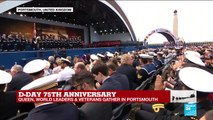 Queen Elizabeth II and world leaders applaud war veterans gathered in Portsmouth for D-Day commemorations.