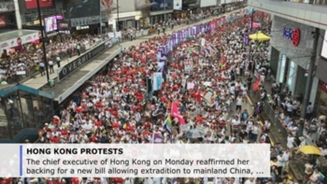HK chief to go forward with extradition bill amid protests but offers tweaks