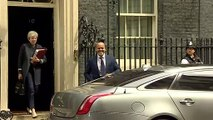 Theresa May departs 10 Downing Street for PMQs