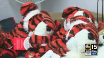 Valley woman designs driver covers for Tiger Woods
